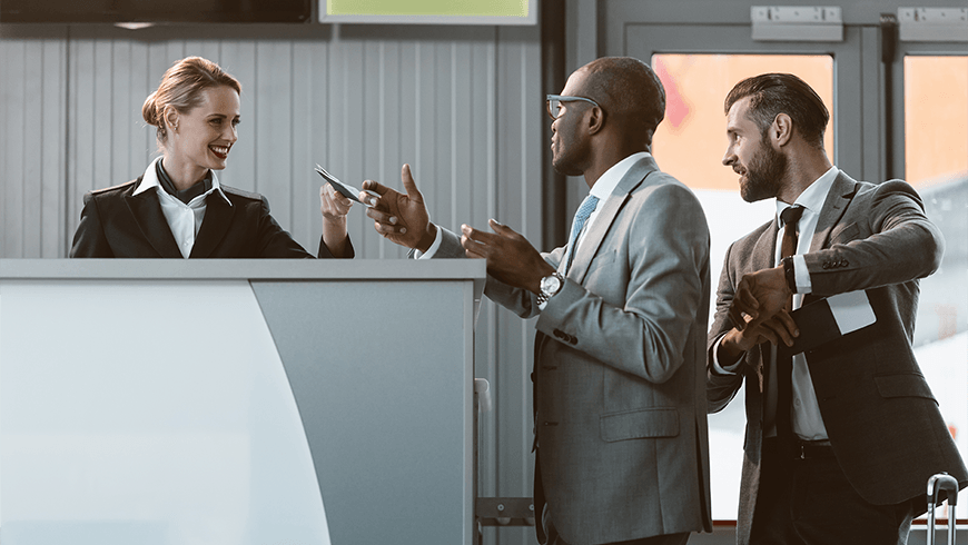 group-of-angry-businesspeople-having-argument-with-airport-receptionist