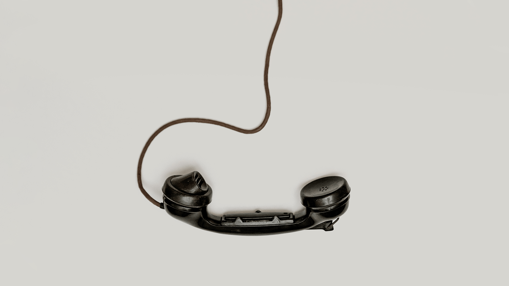 minit-black-corded-telephone-on-the-table